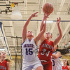Winnacunnet's #15 Katie Valcich and Pinkerton's #24 Sara McLeman reach for a rebound just before the ball goes out of bounds during Monday's Div I Girls Basketball game between Winnacunnet and Pinkerton Academy on 1-6-2015 @ Winnacunnet High School.  Matt Parker Photos