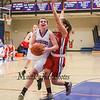 Winnacunnet's #22 Emily Britton drives past Pinkerton's #12 Melissa Martel for a narrowly missed layup during Monday's Div I Girls Basketball game between Winnacunnet and Pinkerton Academy on 1-6-2015 @ Winnacunnet High School.  Matt Parker Photos
