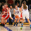 Winnacunnet's #14 Meg Knollmeyer prevents a turnover by safely dribbling the ball out of the corner on a Pinkerton full-court press during Monday's Div I Girls Basketball game between Winnacunnet and Pinkerton Academy on 1-6-2015 @ Winnacunnet High School.  Matt Parker Photos