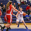 Winnacunnet's #33 Sara Dyer looks to take a layup past Pinkerton's #10 Valerie Martin and #15 Taylor Frost during Monday's Div I Girls Basketball game between Winnacunnet and Pinkerton Academy on 1-6-2015 @ Winnacunnet High School.  Matt Parker Photos
