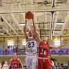 Winnacunnet's #23 Kaya Cadagan grabs an offensive rebound from Pinkerton's #20 Courtney Velho during Monday's Div I Girls Basketball game between Winnacunnet and Pinkerton Academy on 1-6-2015 @ Winnacunnet High School.  Matt Parker Photos