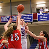 Winnacunnet's #15 Katie Valcich takes a jump shot with pressure from Pinkerton's #15 Taylor Frost and #14 Victoria Overko during Monday's Div I Girls Basketball game between Winnacunnet and Pinkerton Academy on 1-6-2015 @ Winnacunnet High School.  Matt Parker Photos