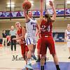 Winnacunnet's #15 Katie Valcich gets past Pinkerton's #24 Sara McLeman with an underhand layup during Monday's Div I Girls Basketball game between Winnacunnet and Pinkerton Academy on 1-6-2015 @ Winnacunnet High School.  Matt Parker Photos