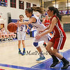 Winnacunnet's #23 Kaya Cadagan attempts to save the ball from going out of bounds with Pinkerton's #14 Victoria Overko and Winnacunnet's #3 Kelly Arsenault looking for the loose ball during Monday's Div I Girls Basketball game between Winnacunnet and Pinkerton Academy on 1-6-2015 @ Winnacunnet High School.  Matt Parker Photos