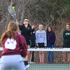 Winnacunnet's Hannah Rogers serves the ball to Derryfield's Lauren Rohlfs while teammate Olivia Husak watches the serve in the #1 Seed Doubles match during Thursday's Girls DIV I  Tennis Meet between Winnacunnet and Derryfield School on 4-16-2015 @ WHS WHS-9, DFS-0. Matt Parker Photos