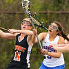 Winnacunnet's #3 Alana Sher gets pressure from Keene's #11 Addie Nelson as she works her way to Keene's net   during Friday's Div II Girls Lacrosse Game between Winnacunnet and Keene High schools on 5-15-2015 @ WHS.  Matt Parker Photos