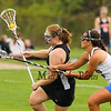 Winnacunnet's #22 Grace Cragg slows up Keene's #24 Erin Myers as she makes her way up the field during Friday's Div II Girls Lacrosse Game between Winnacunnet and Keene High schools on 5-15-2015 @ WHS.  Matt Parker Photos