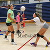Winnacunnet's Junior Maddie Allen (R) and Sophmore Rose Slayton work on a passing drill during a drill at Thursday's Girls Varsity Volleyball preseason practice on 8-20-2015 @ WHS.  Matt Parker Photos