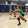 Winnacunnet Senior Paige Duffy bumps the ball back to her partner during a drill at Thursday's Girls Varsity Volleyball preseason practice on 8-20-2015 @ WHS.  Matt Parker Photos