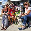 Fremont NH residents (L to R) Jen Toney, Micah Sirois, Airan Sirois and Donna Provencher enjoy seafood at the 2015 Hampton Beach Seafood Festival on Saturday 9-12-2015 @ Hampton Beach, NH.  Matt Parker Photos