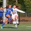 Winnacunnet's #2 Caitlin Trott and Exeter's #25 Becca Jackson hustle to a passed ball during Friday's Div I Girls Soccer game between Winnacunnet and Exeter High Schools on 9-25-2015 @ EHS.  Matt Parker Photos
