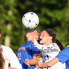 Winnacunnet's #12 Allison Giacalone heads the ball with Exeter's #2 Kyle MacLaughlin during Friday's Div I Girls Soccer game between Winnacunnet and Exeter High Schools on 9-25-2015 @ EHS.  Matt Parker Photos
