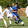 Winnacunnet's #10 Max Chaykowsky breaks up a pass to Exeter's #9 Eddie Zhao during Saturday's Div I Boys Soccer game between Winnacunnet and Exeter High Schools on 9-26-2015 @ EHS.  Matt Parker Photos