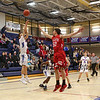 Winnacunnet's #11 Anthony Primavera takes a jump shot with Astros #50 Benjamin Olson stepping in to defend during Tuesday's NHIAA DIV I Boys Basketball game between Winnacunnet and Pinkerton Academy on 1-5-2016 @ WHS.  Matt Parker Photos