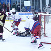 Winnacunnet's #16 Brian Auffant gets the puck in front of the Portsmouth net with Portsmouth Goalie #1 Lance Lovoie and #14 Ryan Holmes defending during Saturday's NHIAA DIV II Boys Ice Hockey game between Winnacunnet and Portsmouth High Schools on 1-9-2016 @ The Rinks at Exeter. Matt Parker Photos