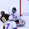 Winnacunnet's Goalie #30 Morgan McGirl takes a shot off his shoulder by Portsmouth's #8 Jack Alden during Saturday's NHIAA DIV II Boys Ice Hockey game between Winnacunnet and Portsmouth High Schools on 1-9-2016 @ The Rinks at Exeter. Matt Parker Photos