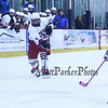 Winnacunnet's #5 Aaron Garrison takes a shot from the wing with Portsmouth's #21 Fred Holmes defending and the Winnacunnet bench looking on during Saturday's NHIAA DIV II Boys Ice Hockey game between Winnacunnet and Portsmouth High Schools on 1-9-2016 @ The Rinks at Exeter. Matt Parker Photos