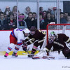 Winnacunnet's #9 James Nash works the puck around the back of the Portsmouth net with Portsmouth's #21 Fred Holmes and Goalie #1 Lance Lovoie able to make the save during Saturday's NHIAA DIV II Boys Ice Hockey game between Winnacunnet and Portsmouth High Schools on 1-9-2016 @ The Rinks at Exeter. Matt Parker Photos