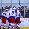 Winnacunnet players celebrate after scoring a goal with Winnacunnet fans cheering them on during Saturday's NHIAA DIV II Boys Ice Hockey game between Winnacunnet and Portsmouth High Schools on 1-9-2016 @ The Rinks at Exeter. Matt Parker Photos