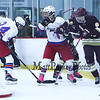 Winnacunnet's #7 Cameron Strukel and #24 Jack Rademacher along with Portsmouth's #23 Oscar Kozikowski and #6 Jared Vincent struggle for control of the puck behind the Winnacunnet goal during Saturday's NHIAA DIV II Boys Ice Hockey game between Winnacunnet and Portsmouth High Schools on 1-9-2016 @ The Rinks at Exeter. Matt Parker Photos