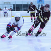 Winnacunnet's #5 Aaron Garrison keeps low while making a tight cut to the net with Portsmouth's #22 Jocob Morin defending  during Saturday's NHIAA DIV II Boys Ice Hockey game between Winnacunnet and Portsmouth High Schools on 1-9-2016 @ The Rinks at Exeter. Matt Parker Photos