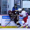 Winnacunnet's #13 Rich Hordon and Portsmouth's #11 Luke LaCroce work to get the puck off the boards during Saturday's NHIAA DIV II Boys Ice Hockey game between Winnacunnet and Portsmouth High Schools on 1-9-2016 @ The Rinks at Exeter. Matt Parker Photos