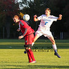 Winnacunnet's Forward #7 Patrick Cotter and Red Raiders #24 Mike Ciccotelli go for a high bouncing loose ball during Friday's NHIAA DIV 1 Boys Soccer game between Winnacunnet and Spaulding High Schools on 10-14-2016 @ WHS.  Matt Parker Photos