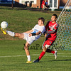 Winnacunnet's #8 Zach Waterhouse kicks the ball over his head to center the ball in front of the Spaulding net with Spauldings #14  Sam Duchesneau defending during Friday's NHIAA DIV 1 Boys Soccer game between Winnacunnet and Spaulding High Schools on 10-14-2016 @ WHS.  Matt Parker Photos