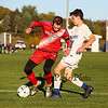 Winnacunnet's Forward #7 Patrick Cotter puts pressure on the Red Raiders Defender #9 Stephen Brady to make a play on the ball during Friday's NHIAA DIV 1 Boys Soccer game between Winnacunnet and Spaulding High Schools on 10-14-2016 @ WHS.  Matt Parker Photos