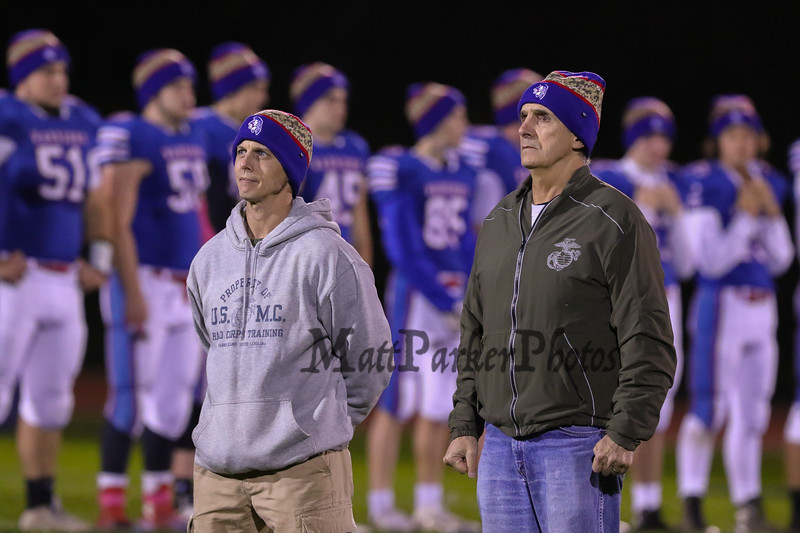 """Marine Veterans and Hampton Residents Dave Hobbs (L) and Ralph Fatello (R) are honored at the Wounded Warrior, """"Hat Trick"""" night ceremony prior to Friday Night's DIV I Football game between Winnacunnet and Spaulding High Schools on 10-14-2016 @ WHS.  Matt Parker Photos"""