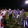 """Winnacunnet and Spaulding Captains with Referees share the 50 yard line with Marine Veterans Ralph Fatello (L) and Dave Hobbs (R) during the Wounded Warrior, """"Hat Trick"""" night ceremony prior to Friday Night's DIV I Football game between Winnacunnet and Spaulding High Schools on 10-14-2016 @ WHS.  Matt Parker Photos"""
