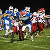 Winnacunnet's #6 Mason Partner tackles Red Raiders RB #7 Christopher McNulty during Friday Night's DIV I Football game between Winnacunnet and Spaulding High Schools on 10-14-2016 @ WHS.  Matt Parker Photos