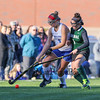 Winnacunnet's #4 Courtney Ingham keeps possession of the ball as Central's #1 Emma Dudley puts on defensive pressure during Friday's NHIAA DIV I Girls Field Hockey game between Winnacunnet and Central High Schools 10-14-2016 @ WHS.  Matt Parker Photos