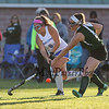 Winnacunnet's #8 Kelly Machkechnie takes a swing to hit the ball up field with Central's #9 Annie Kew attempting to make a block with her stick during Friday's NHIAA DIV I Girls Field Hockey game between Winnacunnet and Central High Schools 10-14-2016 @ WHS.  Matt Parker Photos