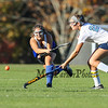 Winnacunnet's Kelly Machkechnie gets a good hit on the ball to move it up field with York's #29 Lily Posternak defending during Monday's Interstate scrimmage between York and Winnacunnet High Schools on 10-17-2016 @ York, ME.  Matt Parker Photos