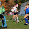 York's #5 Jessa Smith crosses the ball from the wing with Winnacunnet defending during Monday's Interstate scrimmage between York and Winnacunnet High Schools on 10-17-2016 @ York, ME.  Matt Parker Photos