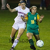 Winnacunnet's #15 Tess Rodgers and BG's #18 Kat Scanion hustle for the ball during Friday's NHIAA DIV I Girls Soccer Game between Winnacunnet and Bishop Guertin High Schools on 10-21-2016 @ WHS.  Matt Parker Photos