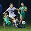 Winnacunnet's #10 Claire Gourgeot gets the ball past BD defender #6 Julie Nigro with #2 Olivia Hilger trailing during Friday's NHIAA DIV I Girls Soccer Game between Winnacunnet and Bishop Guertin High Schools on 10-21-2016 @ WHS.  Matt Parker Photos