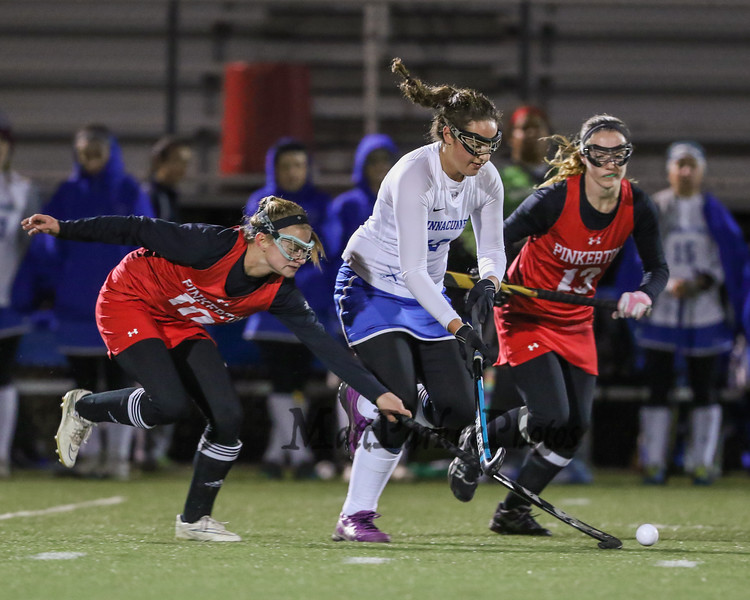 Winnacunnet's #10 Dana Sher gets pressure from Astros #10 Ava Dorci and #13 Delaney Conway as she runs the ball up the field during Tuesday Night's NHIAA DIV I Semifinal Girls Field Hockey game between Winnacunnet HS and Pinkerton Academy on 10-25-2016 @ Exeter HS.  Matt Parker Photos