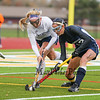 York's #7 Sydney Bouchard and Yarmouth's #13 Nicole McDowell reach for a loose ball during Wednesday's Maine principals' Association Class B Southern Maine Regional Field Hockey Finals between York and Yarmouth High School on 10-26-2016 @ Massabesic HS, Waterboro, ME.  Matt Parker Photos