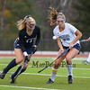 York's #29 Lily Posternak and Yarmouth's #11 Eliza Lunt concentrate on a loose ball during Wednesday's Maine principals' Association Class B Southern Maine Regional Field Hockey Finals between York and Yarmouth High School on 10-26-2016 @ Massabesic HS, Waterboro, ME.  Matt Parker Photos