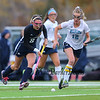 York's #12 Ally Lawlor chases Yarmouth's #8 Abby McDowell as the ball heads into York territory during Wednesday's Maine principals' Association Class B Southern Maine Regional Field Hockey Finals between York and Yarmouth High School on 10-26-2016 @ Massabesic HS, Waterboro, ME.  Matt Parker Photos