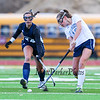 York's #12 Ally Lawlor takes a big swing at the ball to move it up field with Yarmouth's #24 Molly Wilson defending  during Wednesday's Maine principals' Association Class B Southern Maine Regional Field Hockey Finals between York and Yarmouth High School on 10-26-2016 @ Massabesic HS, Waterboro, ME.  Matt Parker Photos