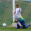 Winnacunnet's #2 Keelyn McNamara rushes the Salem Goal Keeper Jessica Tracey as she makes a save by deflecting the ball out of bounds setting up a Winnacunnet corner kick during Thursday's NHIAA DIV I Girls Soccer Preliminary round between Winnacunnet (7) and Salem (10) High Schools on 10-27-2016 @ WHS.  Matt Parker Photos