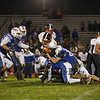 Keene's RB #24 Alex Stroshine is tackled and brought down by Winnacunnet's #34 Kevin Miller and #28 John Ferrelli during Friday Night's NHIAA DIV I football game between Winnacunnet and Keene High Schools on 10-28-2016 @ WHS.  Matt Parker Photos