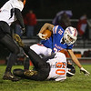 Winnacunnet's RB #30 Nate Estabrook is tackled by Blackbirds #60 Sam Fairbanks but not before running up the middle for a 1st down during Friday Night's NHIAA DIV I football game between Winnacunnet and Keene High Schools on 10-28-2016 @ WHS.  Matt Parker Photos