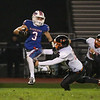 Winnacunnet's RB #3 Billy Powers jumps to avoid a tackle by Keene's #53 Colby Byrne during Friday Night's NHIAA DIV I football game between Winnacunnet and Keene High Schools on 10-28-2016 @ WHS.  Matt Parker Photos