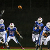 Winnacunnet's QB #17 Patrick MacDougall throws the ball for a completion to WR #81 Logan Keene with #51 Ryan Hanson blocking and #30 Nate Estabrook covering during Friday Night's NHIAA DIV I football game between Winnacunnet and Keene High Schools on 10-28-2016 @ WHS.  Matt Parker Photos