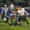 Keene's QB #2 Sean Corrigan fumbles the ball when tackled by Winnacunnet's #28 John Ferrelli with #56 Corey Markland looking to make a recovery during Friday Night's NHIAA DIV I football game between Winnacunnet and Keene High Schools on 10-28-2016 @ WHS.  Matt Parker Photos
