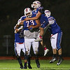 Winnacunnet's DL #73 Seth Provencher is congratulated by team mates after making an interception on a Blackbirds pass and running the ball in for a touch down during Friday Night's NHIAA DIV I football game between Winnacunnet and Keene High Schools on 10-28-2016 @ WHS.  Matt Parker Photos